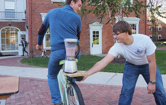 Levi Lundell, '17, and Bennett Gould, '17, use a bike powered blender to make smoothies.