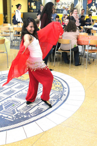 Natali Salaytah, '19, performs a traditional Muslim belly dance at the Eid al Adha dinner on Oct. 1, 2015.