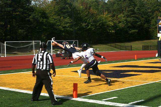 Lucas Morton, '16, misses a touchdown pass during the game against Kenyon College on Sept. 26, 2015.