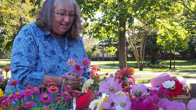 Nancy Schultz, a Meadville resident, sells create-your-own bouquets of flowers on Brooks Walk at the annual DeHart Local Foods Market on Thursday, Oct. 1, 2015.