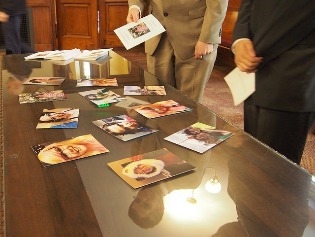 Friends and family of Hannah Morris look over photos which capture her happier moments after the memorial in Ford Chapel on Saturday, Nov. 14. 2015.