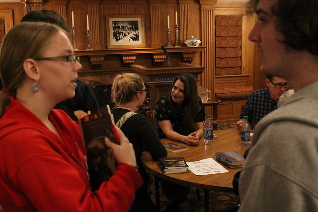 Nicky Beer and Brian Barker hold a book signing after a poetry reading in Tippie Alumni Center on Thursday, Nov. 5, 2015.