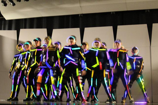 Women's softball gets creative with their routine at the All-Athlete Talent Show and uses glow sticks on stage while Shafer Auditorium turns the lights down so the team would glow.  The softball team placed third at the talent show on Wednesday, Nov. 11, 2015.