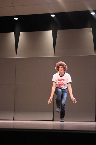 Thomas Manning, '16, a member of the men's tennis team performs as Napoleon Dynamite before he is joined by his teammates on stage.