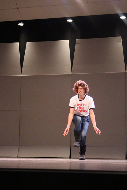 Thomas Manning, 16, a member of the mens tennis team performs as Napoleon Dynamite before he is joined by his teammates on stage.