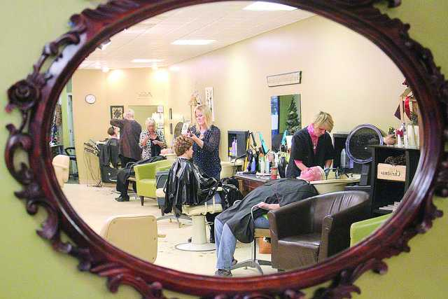 Kathy Perry gives 15-year customer of Hairitage Salon Connie Deitman a haircut on Monday, Nov. 30, 2015. Deitman originally was a client of the owner, Candy Hart, before switching over to Perry. Perry and Hart have shared clients and memories for 29 years since Hart took ownership of the salon. Perry said she would go anywhere in order to stay loyal to her friends and beautician.