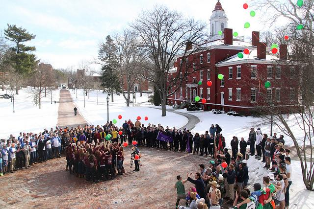 Greek organizations gather in Brooks circle for Run-Out on Saturday, Jan. 23, 2016 to introduce and welcome their new members to Allegheny Greek Life.  Alpha Chi Omega sorority releases balloons every year as a part of their ritual. Greek life on campus represents more than 150 years of service, tradition and community according to the Allegheny College website.