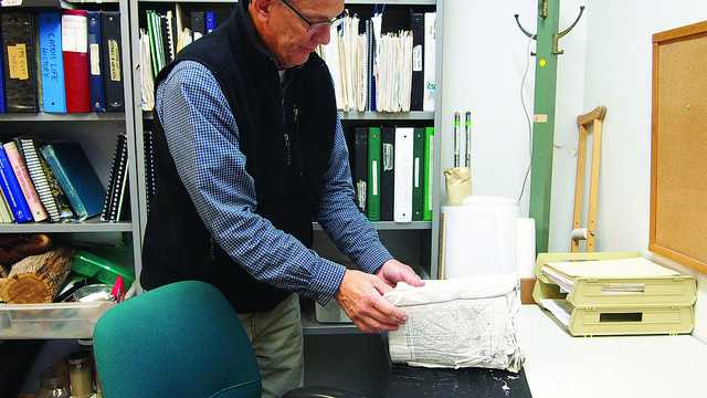 Scott Wissinger, professor of biology, looks over items that were damaged by the flooding in Steffee on Nov. 22, 2015. According to Eric Young, Meadville chief of police, the department is still conducting and investigation into the incident. The college is still calculating costs, but the repairs that were done over break have added up to more than $160,000.