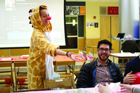 Hanna Adus, the German teaching assistant, throws candy on the table while Justin Jurczyk, '17, and friends enjoy authentic German food.