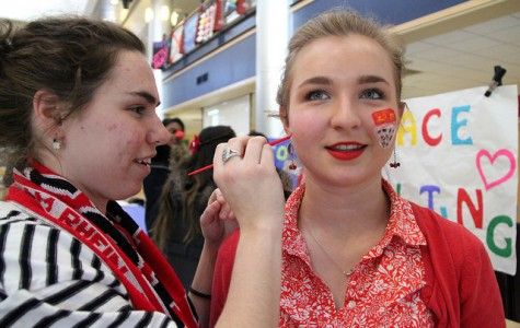 Maggie Dugan, '18, paints the face of Elsie Hendricks, '18, during Karneval on Thursday, Feb. 18, 2016. Both students studied abroad in Cologne, Germany last semester and experienced Karneval in the city.
