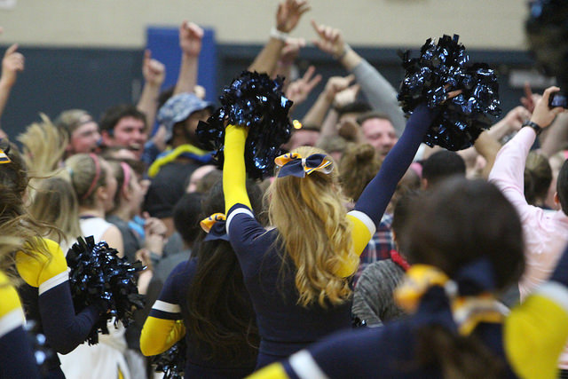 Cheerleader Jordann Kline, 19, rushed the court along with the other cheerleaders and spectators after Allegheny womens basketball beat Oberlin College 58-50.