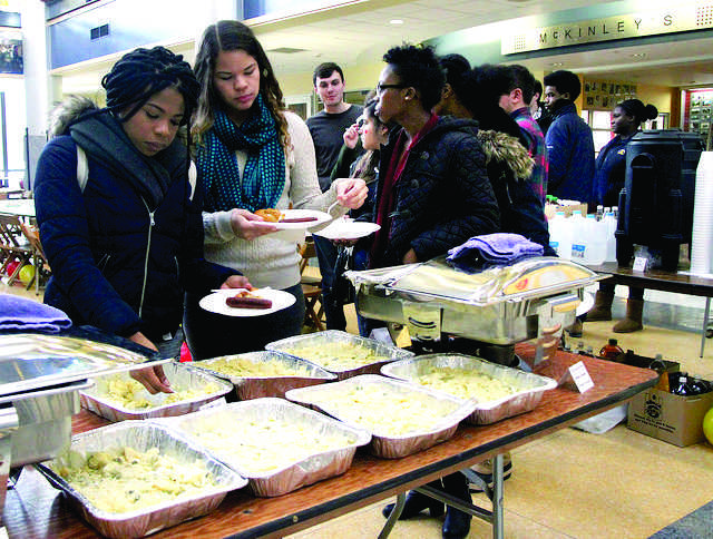 Students eat potato salad, sausages and pretzels at the event on Thursday, Feb. 18, 2016 in the campus center.