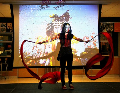 Winly Mai, '18, performs a ribbon dance for the Chinese Lantern Festival, which focused on celebration and reunion with family and friends.