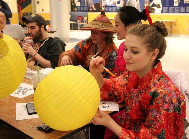 Hannah Firestone, '19, decorates one of the paper lanterns available on the many tables set up for the Chinese Lantern Festival in the Campus Center lobby on Sunday, Feb. 21, 2016.