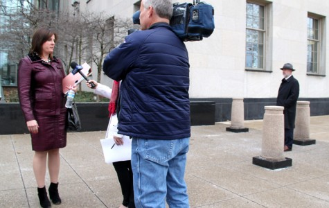 Kirk Nesset's attorney, Meagan Temple, speaks with the news outside of the Federal District Court building following the sentencing of the former Allegheny College professor on Feb. 8, 2016