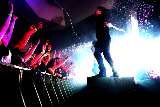 Hoodie Allen and his band fling water at the crowd from their water bottles in Shafer Auditorium on March 5, 2016.