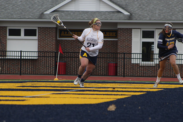 McKenzie Bell, '16, attack, looks for a teammate to pass to during the women's lacrosse game against Augustana College on Tuesday, March 1, 2016. The Gators fell 9-8 to the Vikings in their first game of the season.
