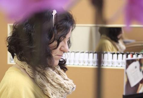 Tamara Kolesnichenko paints a customer's nails on March 4, 2016. Kolesnichenko opened Tamara's Salon in June 2015 to make a dream become reality.