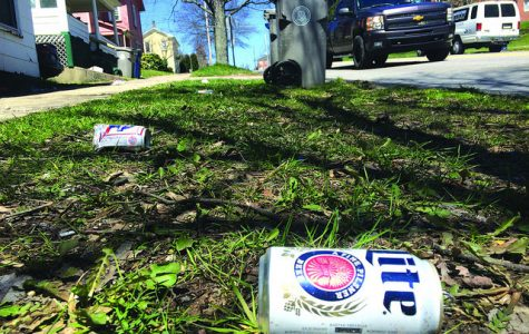 Beer cans litter the side of Park Avenue on Thursday, April 14, 2016, following Springfest activities the weekend prior.