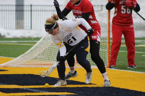 McKenzie Bell, '16, goes for a ground ball in the game against Wittenberg University on Sunday, April 10, 2016. This season, Bell broke the point record on March 23 and was named NCAC Player of the Week on April 10.