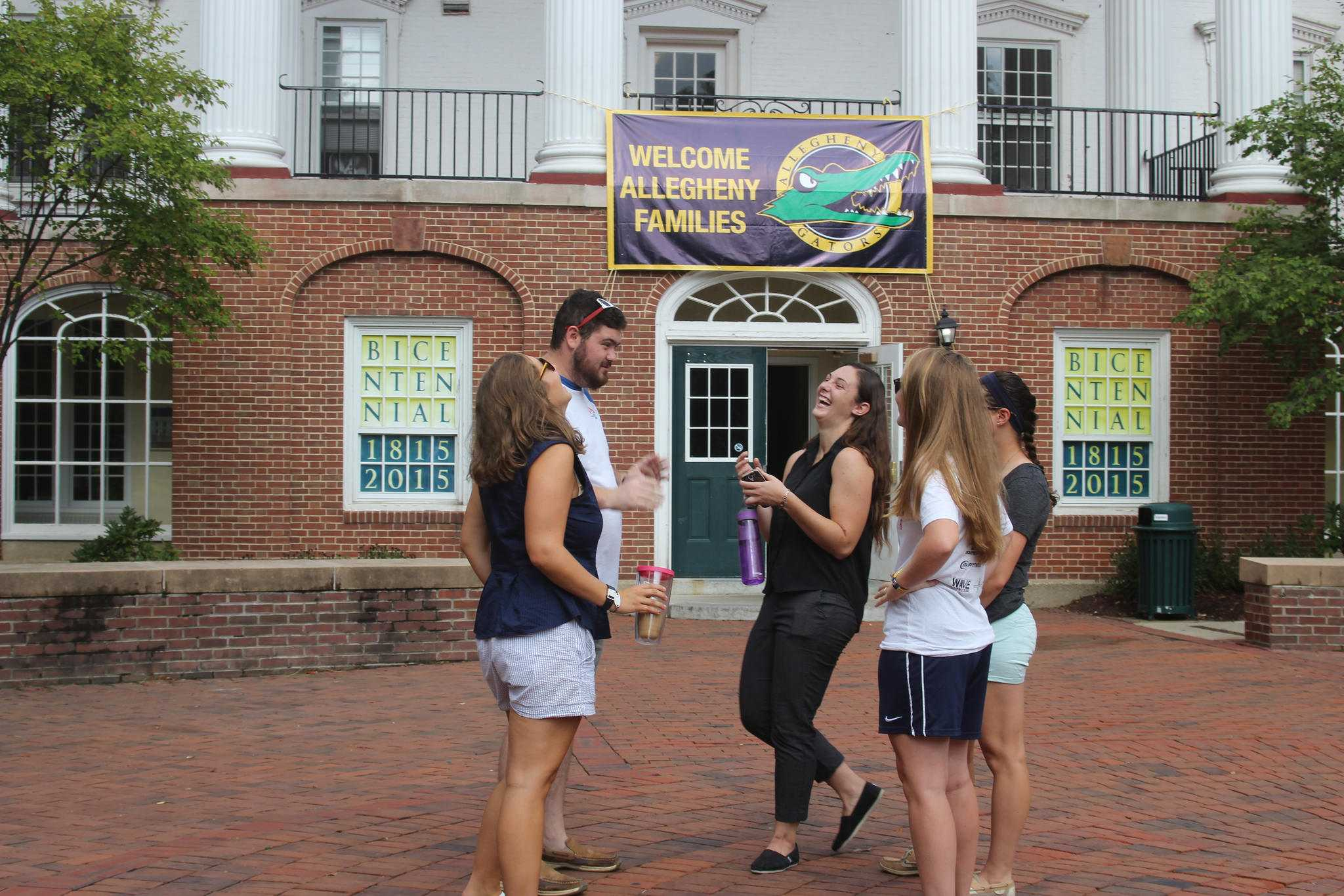 Gator Guides Maddie Baric, '17, Robinson Whitaker, '17, Allison Cabo, '17, Alexa Maloney, '17, and Sarah Basden, '19, stand outside of Brooks Hall before their training on Aug. 25, 2016. Gator Guides lead campus tours.