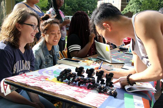 Kathleen Reed, '19 and Jeannie Choi, '17 promote Association for Asian and Asian American while Weihao Liang, '20 sign up for the organization at the Involvement Fair on Thursday, Sept. 1, 2016.