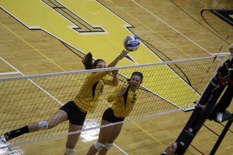 Karissa Welker, '18, and Leah Franzluebbers, '18, work for a point on Saturday, Sept. 10 against Westminster College.