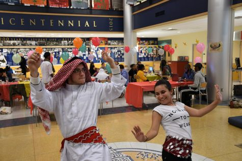 Noah Dawgiello, '19, and Natali Salaytah, '19, dance during the celebration of Eid al-Adha in the campus center lobby on Sunday, Sept. 25, 2016.