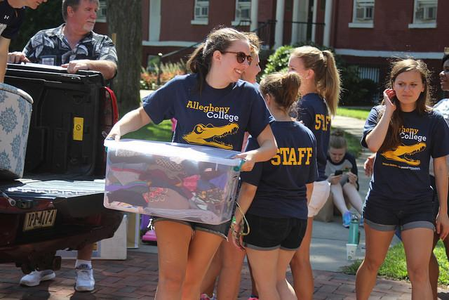 Representing Allegheny Gator Guides, Maria Graziano, '19, helps move in first-year women and their families into Brooks Hall on Saturday, Aug. 27, 2016. Allegheny Gator Guides work for the Admissions office and give tours throughout the year to prospective students and families.