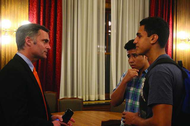 Darrell Park, '91, speaks with George Castellon Castillo, '20, and Hamza Masaeed, '20, after delivering his lecture on the politics of federal budgeting on Friday, Sept. 9, 2016. Park offered to work individually with students through a short course he is currently offering at the college.