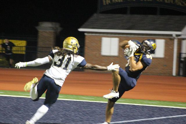 Wide-receiver+Alex+Hutchin%2C+%E2%80%9918%2C++catches+a+pass+in+endzone+on+Saturday%2C+Sept.+3%2C+2016+in+the+season+opener+game+against+Thiel+College+at+Robertson+Athletic+Complex.