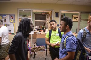 Epps discusses collaboration between student diversity organizations with Karol Vargas, '19 and Francisco Guzman, '19, who are leaders with the Men of Color Advancement Association.
