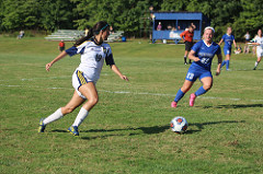 Isabella Martinez, '19, looks for a teammate to pass to against Fredonia.