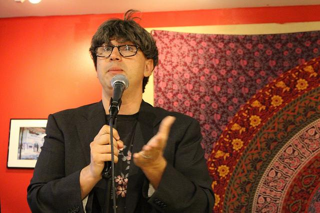 "Peterson Toscano, performance artist, gay activist and Bible scholar, delivers his one-man presentation ""There's Something Gay About Climate Change"" in Grounds for Change on Tuesday, Oct. 18, 2016. Toscano used comedic relief through monologues and character changes to look at queer responses to climate change."
