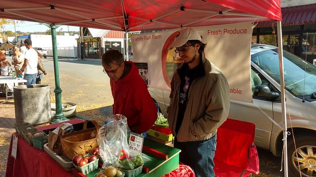 James Coxon, a produce gardener, and his son, Ryan, examine their stock at the Meadville Market House farmers market on Saturday, Oct. 15, 2016.