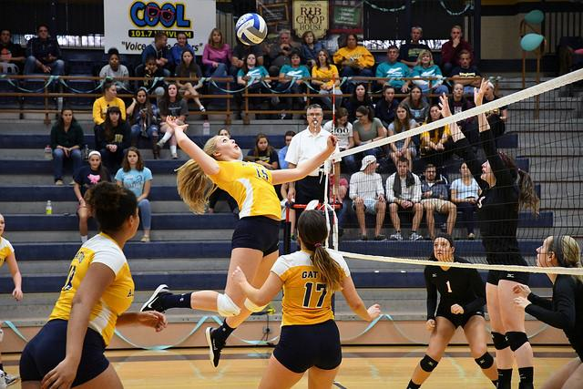 YUTONG WANG/THE CAMPUS Lauren Duffy, '20, hits the ball over the net during the Battle 4 Bridget game against Denison University on Saturday, Oct. 15, 2016. The Gators lost 3-1 to Denison.