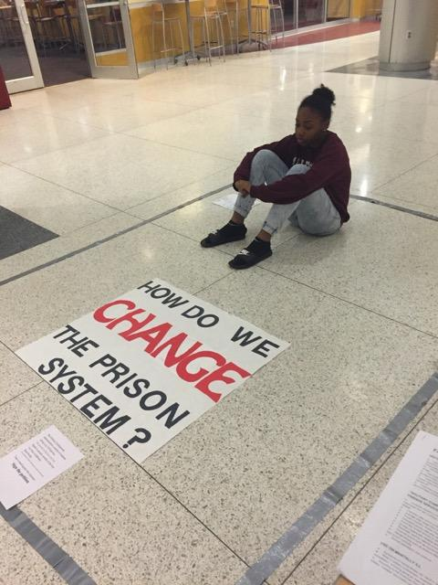 Nadja Knox, '17, sits in a 7 foot by 9 foot box in the campus center lobby on Wednesday, Oct. 19, 2016, as part of a 24-hour demonstration organized by the Student Alliance for Prison Reform to raise awareness about solitary confinement.
