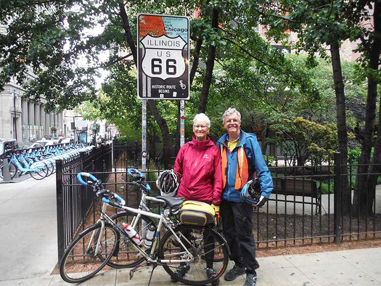 Board of Trustees member Sue Steven, '75, and her husband, Craig Blasingame, pose in front of a Route 66 sign in Chicago, Illinois at the end of their bike trip from California to Chicago on Oct. 2, 2016.