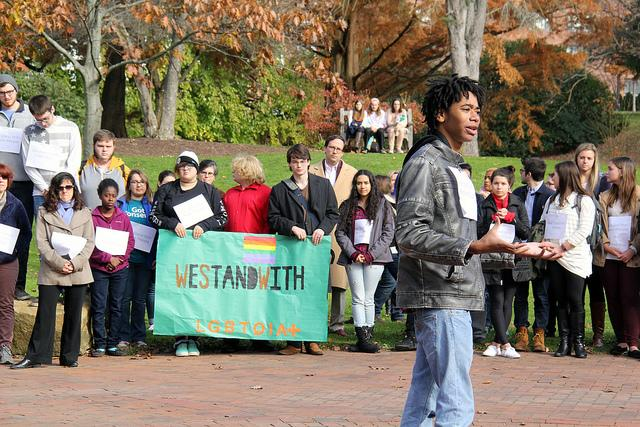 Elijah Prince, '18, speaks to assembled demonstrators gathered in Brooks Circle to stand with and support groups affected by the election of Donald Trump on Monday, Nov. 14, 2016.
