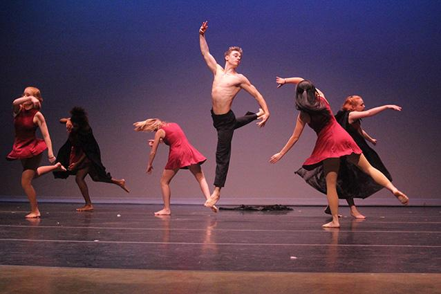 """Yilin Zhu, '17, choreographed a dance to """"Take Me to Church"""" by Hozier where the dancers wore red and black and used black capes as props."""