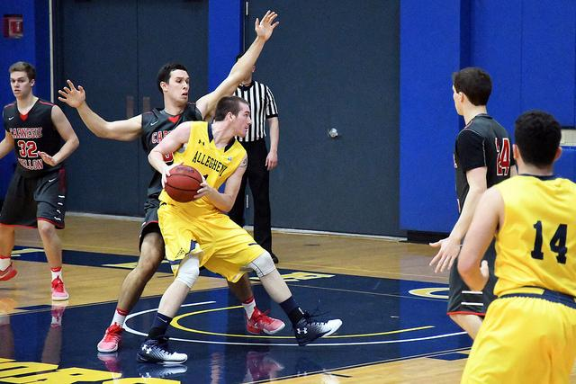 Sean Dougherty, '16, storms the basket during the men's basketball game against Carnegie Mellon.