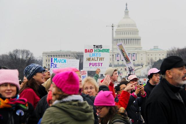 Protesters+hold+signs+as+they+march+on+the+National+Mall+in+Washington%2C+D.C.%2C+on+Friday%2C+Jan.+21%2C+2017%2C+as+part+of+the+Women%E2%80%99s+March+on+Washington.+