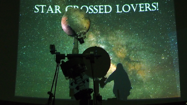 "The Astronomy Club hosts its annual ""Star Crossed Lovers"" event in the Carr Hall planetarium on Monday, Feb. 13, 2017. Prior to the event, guests filled out a survey which club board members used to pair people up at random. Guests had a chance to win a telescope. At the event, James Lombardi, associate professor of physics, explained the basics of when and where certain constellations could be seen in the night sky."