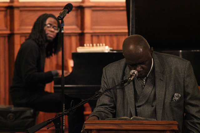 Reverend Carl Terry delivers a sermon at Faith Night, a service for Faith Week, while Associate Director of the Inclusion, Diversity, Equity, Access and Social Justice Center Darnell Epps plays the piano on Feb. 8, 2017, in Ford Memorial Chapel.