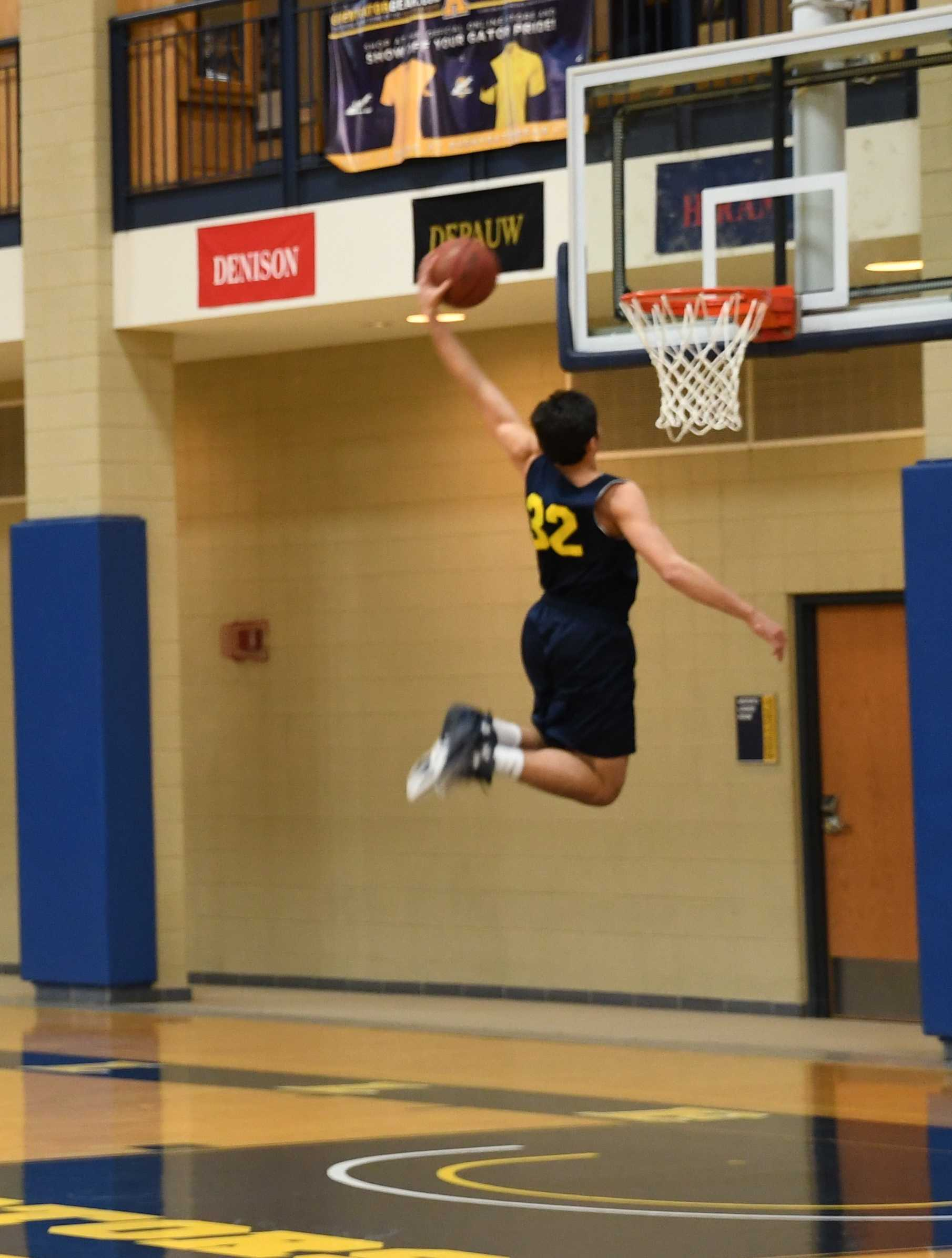 Issac Manton, '20, a guard on the men's team, works on his lay up during practice on Wednesday, Feb. 1, 2017.