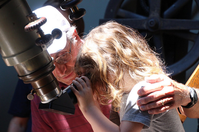 Jim Lombardi, a former professor of physics at Allegheny, shows Lila Finaret how to observe the eclipse through the Newton Observatory telescope on Monday, Aug. 21, 2017.