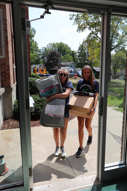 Maria Graziano, '19, and Cecily Milligan, '18, help first-year students move into Ravine-Narvik Hall on Saturday, Aug. 26, 2017.