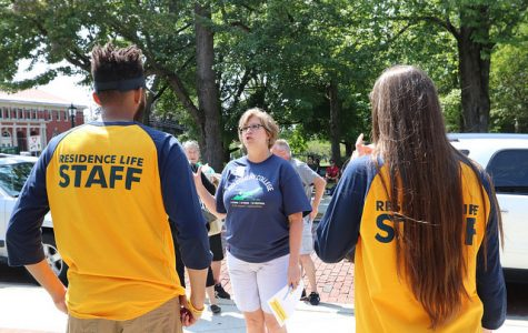 Linda Clune, senior associate director of admissions, directs two members of residence life staff of Baldiwn Hall on Saturday, Aug. 26, 2017.