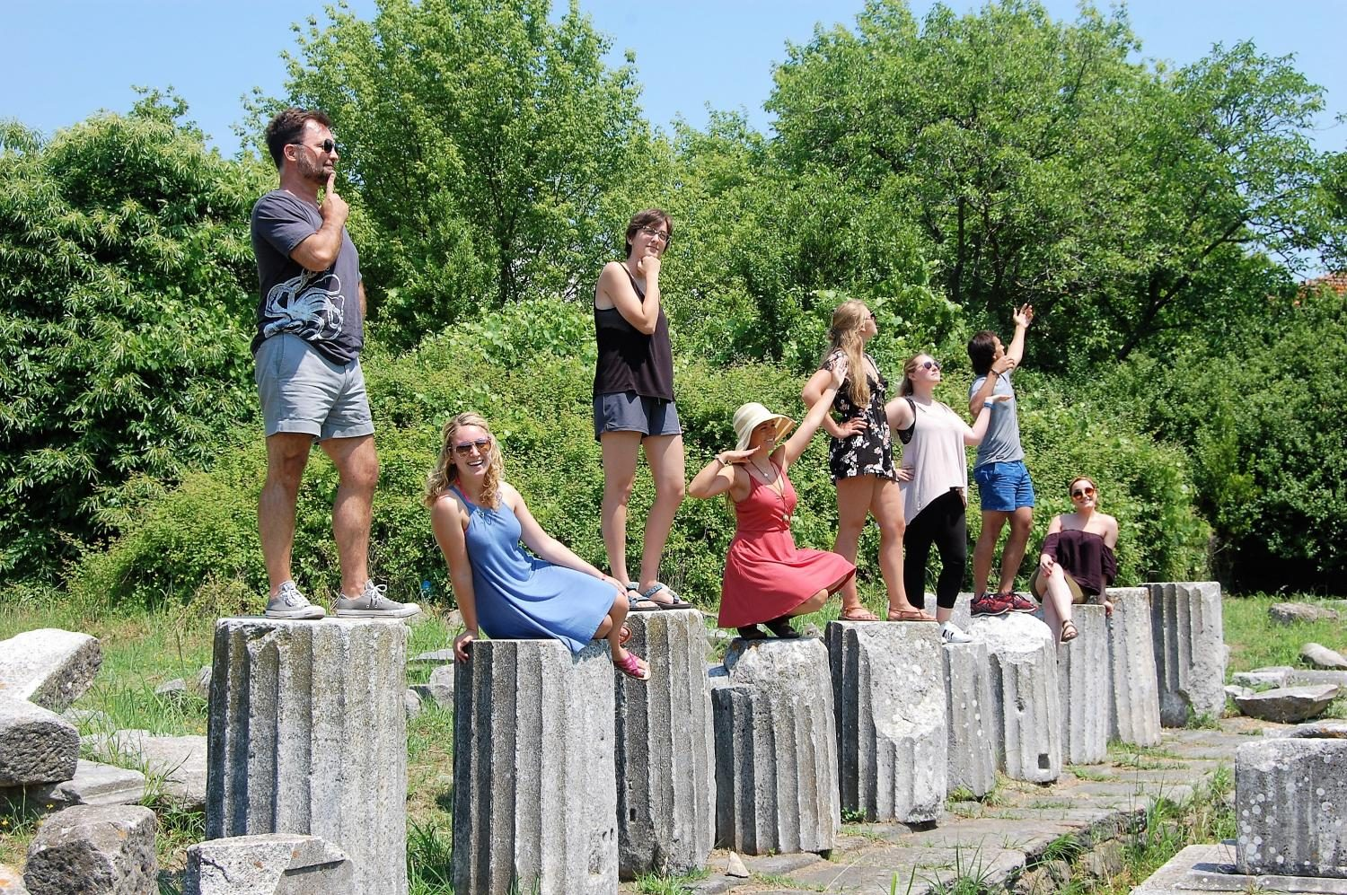 Students pose as sculptures in the Roman Agora at Limenas in Thasos, Greece.