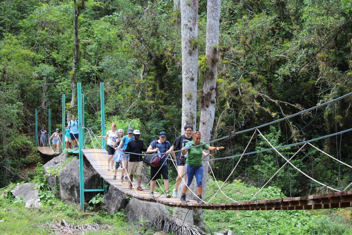 Students hike through Topes de Collantes National Park in the Escambray Mountains, Cuba.